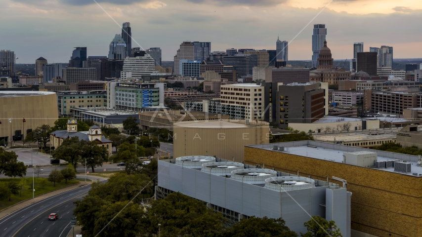 A view of hospital, skyscrapers and capitol dome at sunset in Downtown Austin, Texas Aerial Stock Photos | DXP002_105_0009
