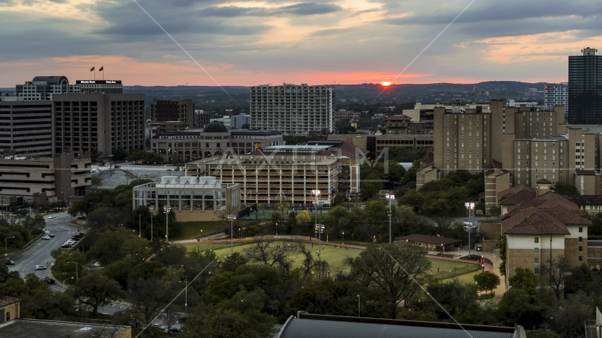 The setting sun in the distance while flying near the university, Austin, Texas Aerial Stock Photos | DXP002_105_0013