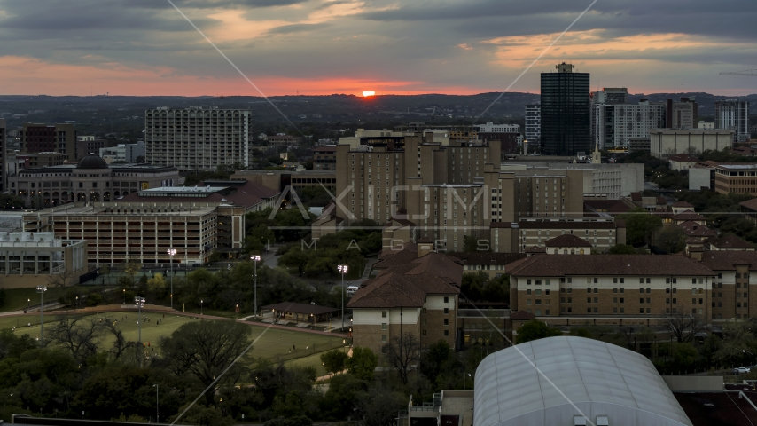 The university campus with setting sun in distance, Austin, Texas Aerial Stock Photos | DXP002_105_0014