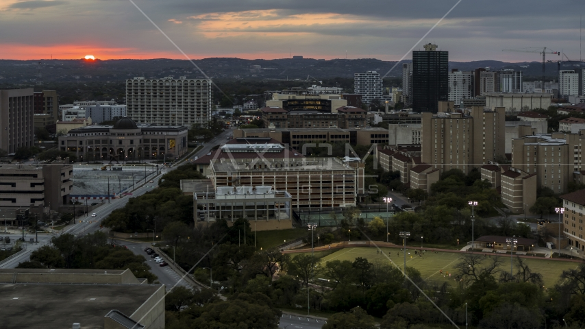 A view of the university campus with setting sun in distance, Austin, Texas Aerial Stock Photos | DXP002_105_0015