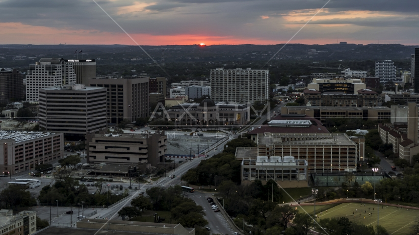 The setting sun behind university campus, Austin, Texas Aerial Stock Photo DXP002_105_0017 | Axiom Images