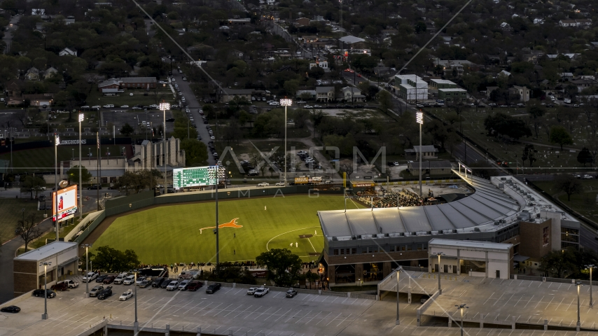 A baseball game at a stadium at the University of Texas at twilight, Austin, Texas Aerial Stock Photos | DXP002_105_0018