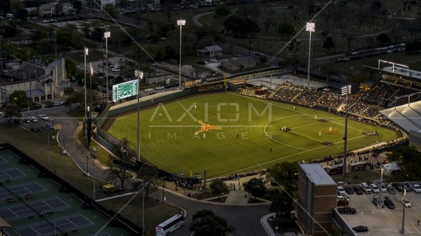 View of a baseball game at a stadium at the University of Texas at twilight, Austin, Texas Aerial Stock Photo DXP002_105_0019 | Axiom Images