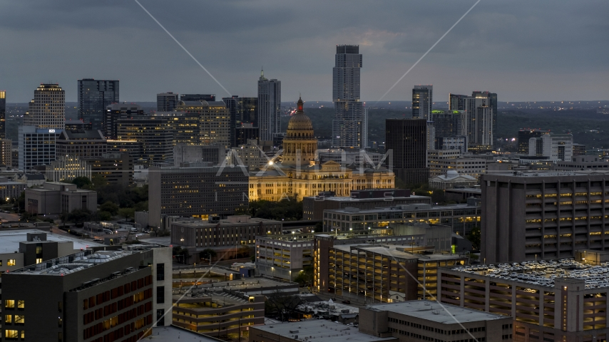 A view of office buildings, capitol and skyscrapers at twilight in Downtown Austin, Texas Aerial Stock Photos | DXP002_105_0020