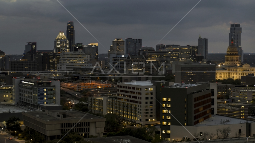 A view of office buildings, skyscrapers near capitol dome at twilight in Downtown Austin, Texas Aerial Stock Photos | DXP002_105_0024