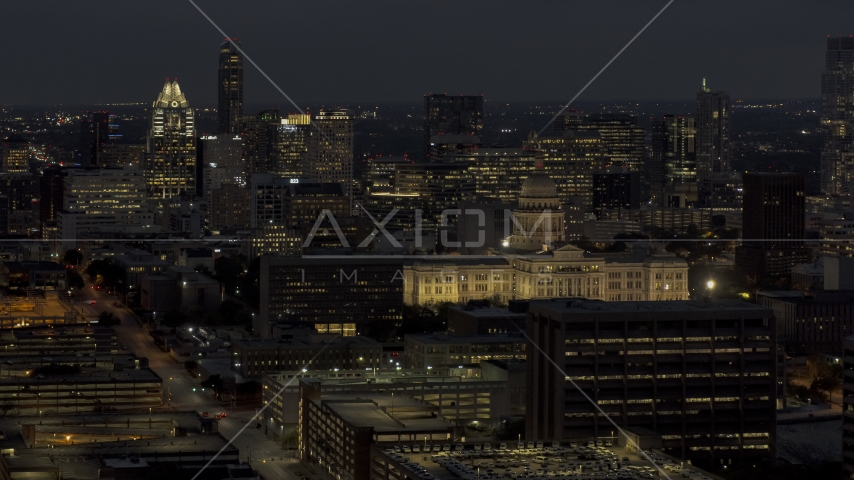 Office buildings, skyscrapers and capitol at night in Downtown Austin, Texas Aerial Stock Photos | DXP002_106_0001