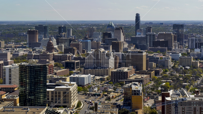 The capitol dome, office buildings and city skyline in Downtown Austin, Texas Aerial Stock Photos | DXP002_108_0003