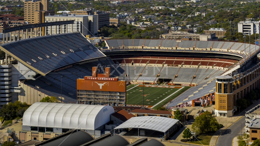 A view of the empty football stadium at the University of Texas, Austin, Texas Aerial Stock Photo DXP002_108_0005 | Axiom Images