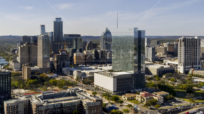 A hotel and the city's skyline in Downtown Austin, Texas Aerial Stock Photo DXP002_108_0016   Axiom Images