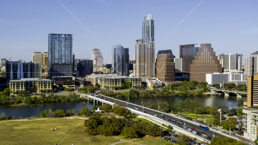 A view of the city's skyline across Lady Bird Lake seen from a bridge, Downtown Austin, Texas Aerial Stock Photos | DXP002_109_0002