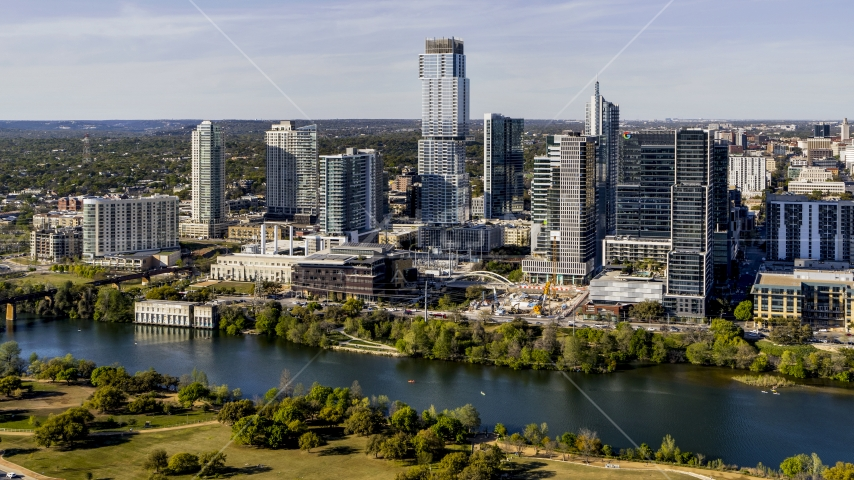 A modern skyscraper across Lady Bird Lake, Downtown Austin, Texas Aerial Stock Photo DXP002_109_0008 | Axiom Images