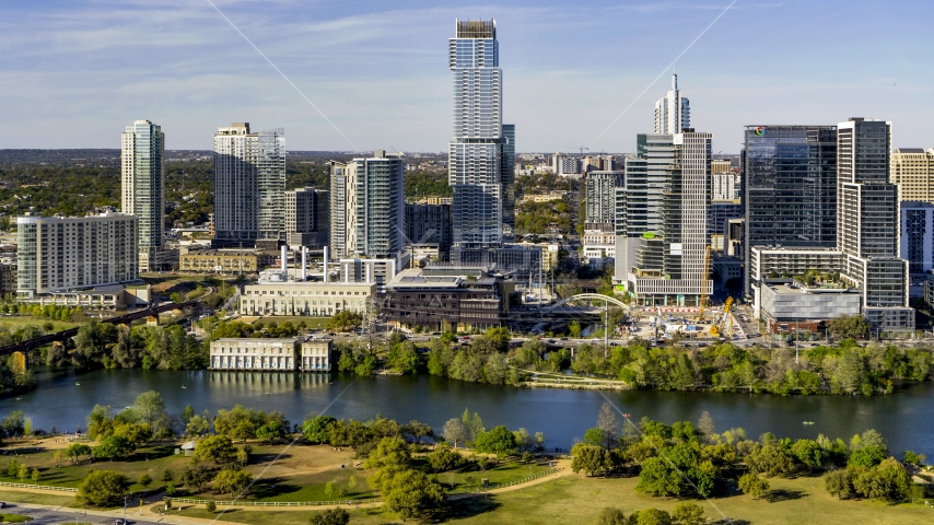 A modern skyscraper on the opposite side of Lady Bird Lake, Downtown Austin, Texas Aerial Stock Photo DXP002_109_0009 | Axiom Images