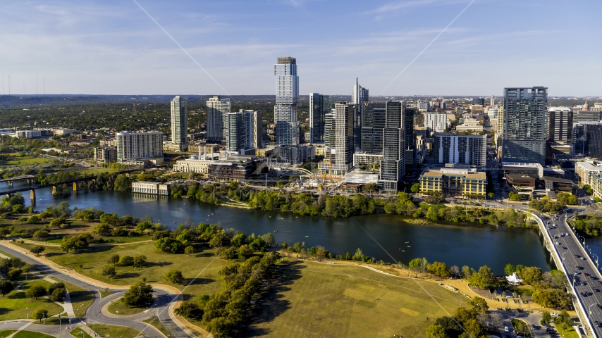 Skyscrapers in the city's waterfront skyline on the other side of Lady Bird Lake, Downtown Austin, Texas Aerial Stock Photo DXP002_109_0014 | Axiom Images
