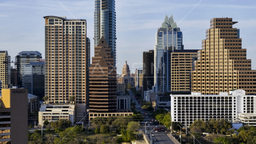 The state capitol building seen between skyscrapers in Downtown Austin, Texas Aerial Stock Photos DXP002_109_0017 | Axiom Images