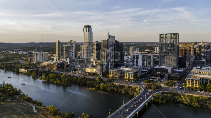 A view of the city's waterfront skyline and Lady Bird Lake at sunset in Downtown Austin, Texas Aerial Stock Photo DXP002_110_0001 | Axiom Images