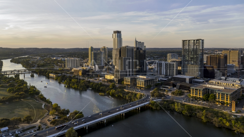 The city's waterfront skyline and Lady Bird Lake at sunset in Downtown Austin, Texas Aerial Stock Photos | DXP002_110_0002