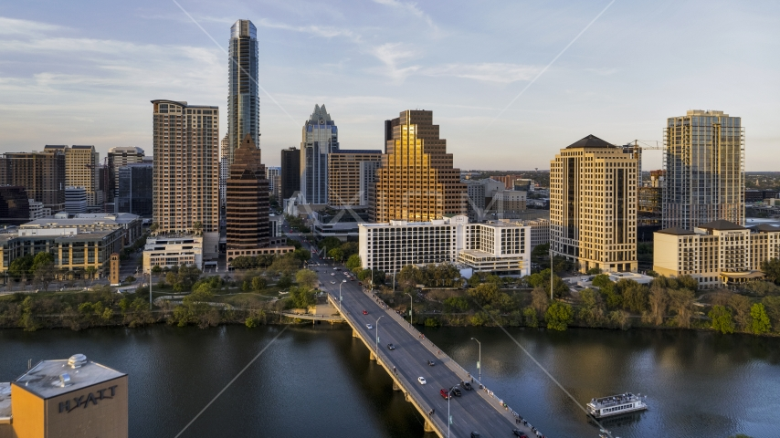 Waterfront skyscrapers across Lady Bird Lake at sunset in Downtown Austin, Texas Aerial Stock Photos   DXP002_110_0003