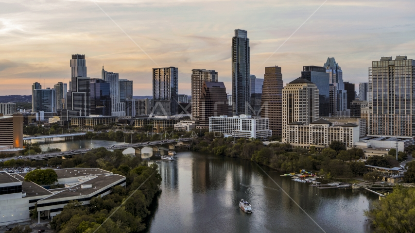 A view of Lady Bird Lake and the skyline at sunset in Downtown Austin, Texas Aerial Stock Photo DXP002_110_0005 | Axiom Images