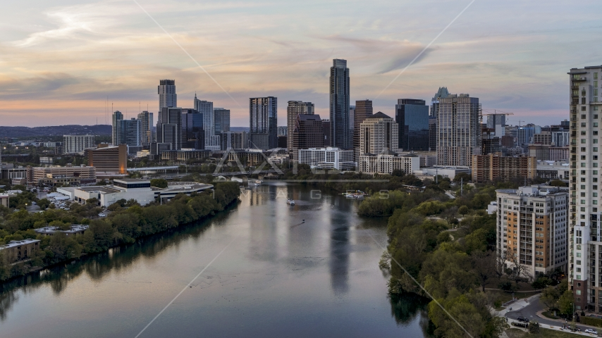 The waterfront skyline by Lady Bird Lake at sunset in Downtown Austin, Texas Aerial Stock Photos | DXP002_110_0006