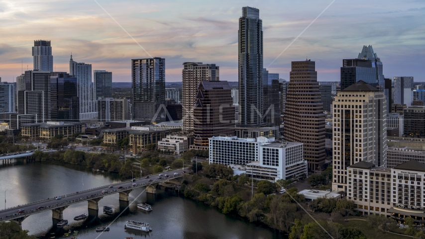 The Austonian in city skyline by Lady Bird Lake at twilight in Downtown Austin, Texas Aerial Stock Photos | DXP002_110_0008