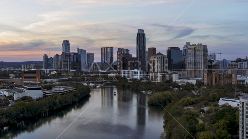 The city waterfront skyline by Lady Bird Lake at twilight in Downtown Austin, Texas Aerial Stock Photo DXP002_110_0010 | Axiom Images