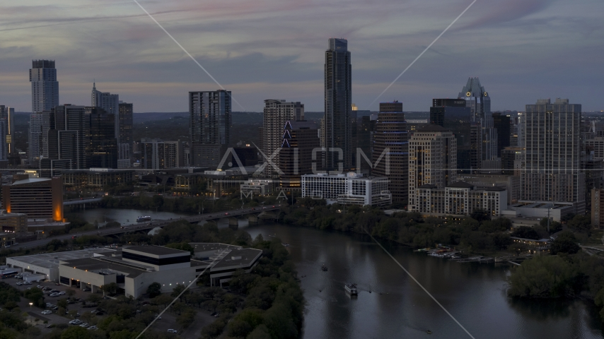 The skyline by Lady Bird Lake and bridge at twilight in Downtown Austin, Texas Aerial Stock Photos   DXP002_110_0015
