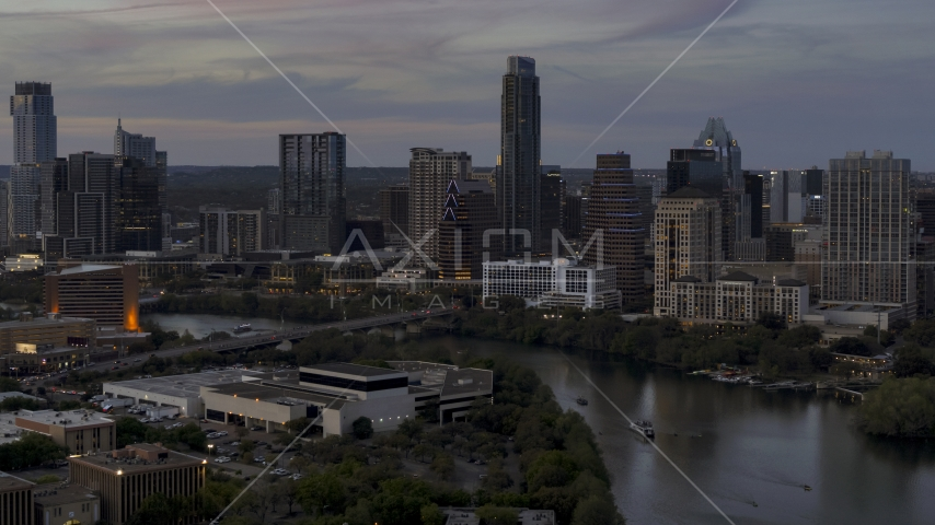 Focus on skyline by Lady Bird Lake and bridge at twilight in Downtown Austin, Texas Aerial Stock Photos | DXP002_110_0016