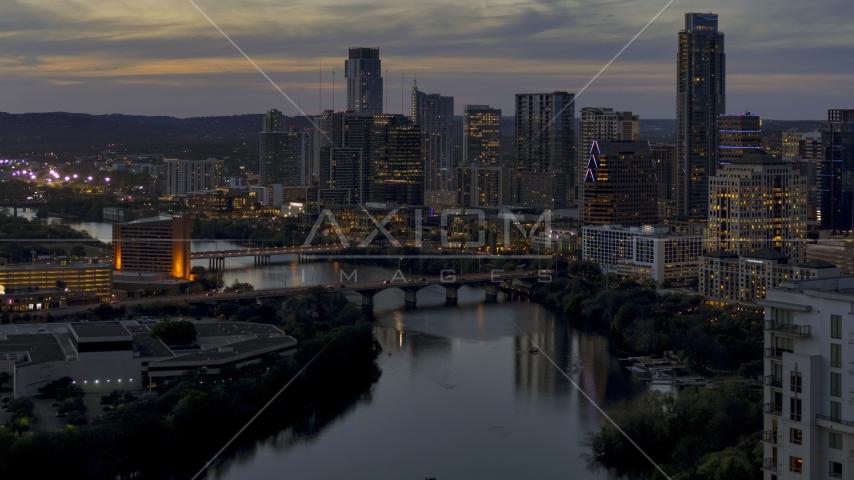 The Congress Avenue Bridge, Lady Bird Lake, skyline at twilight in Downtown Austin, Texas Aerial Stock Photos | DXP002_110_0021