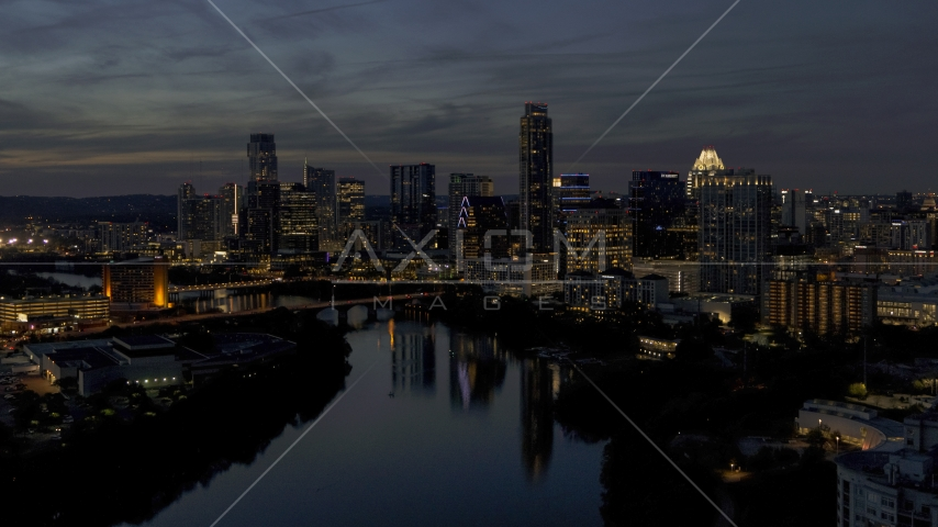 The waterfront skyline on the shore of Lady Bird Lake at twilight in Downtown Austin, Texas Aerial Stock Photos | DXP002_111_0003