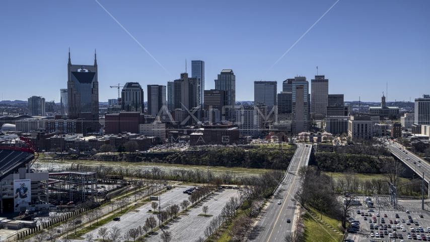 The city's skyline near the river in Downtown Nashville, Tennessee Aerial Stock Photos | DXP002_112_0001