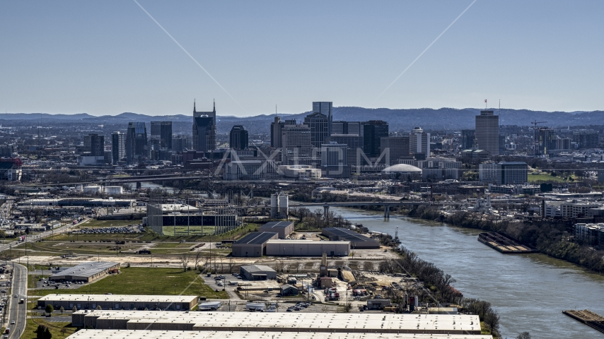 The city's skyline by the Cumberland River in Downtown Nashville, Tennessee Aerial Stock Photos | DXP002_112_0006