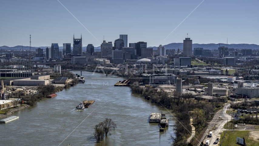 A barge on the river and the city's skyline, Downtown Nashville, Tennessee Aerial Stock Photos | DXP002_112_0007