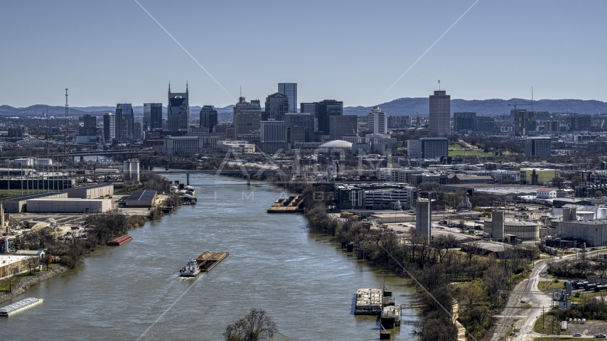 A barge sailing the river toward the city's skyline, Downtown Nashville, Tennessee Aerial Stock Photo DXP002_112_0008 | Axiom Images