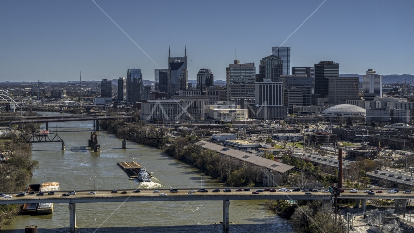 The city skyline seen from traffic on bridge over the river, Downtown Nashville, Tennessee Aerial Stock Photos | DXP002_113_0002