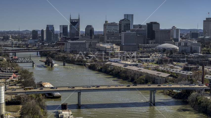 Skyscrapers in the city's skyline, seen from a bridge over the river, Downtown Nashville, Tennessee Aerial Stock Photos | DXP002_113_0003