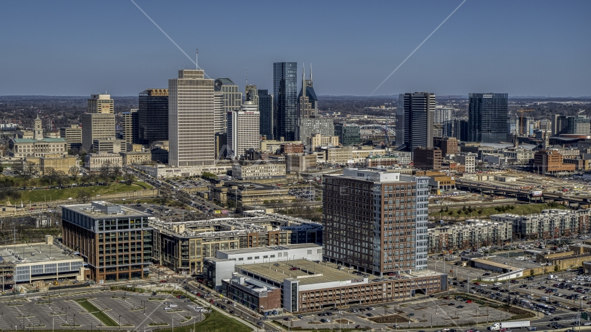A view of city's skyline behind office and apartment buildings in Downtown Nashville, Tennessee Aerial Stock Photos | DXP002_113_0005