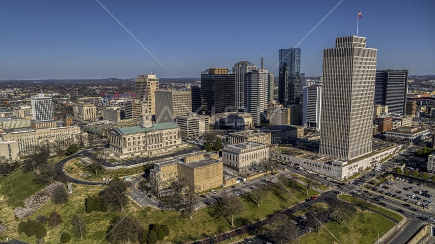 A view of the Tennessee State Capitol, skyscrapers, and Tennessee Tower in Downtown Nashville, Tennessee Aerial Stock Photos | DXP002_114_0004