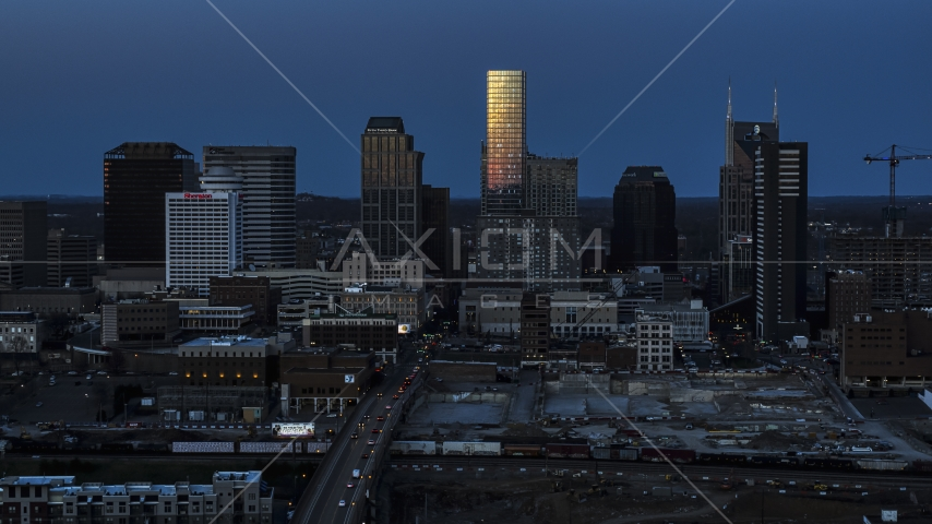 Light reflecting off skyscrapers in city's skyline, seen from Church Street at twilight in Downtown Nashville, Tennessee Aerial Stock Photos | DXP002_115_0002