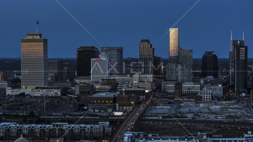 A view of light reflecting off skyscrapers in city's skyline, seen from near Church Street at twilight in Downtown Nashville, Tennessee Aerial Stock Photos | DXP002_115_0005