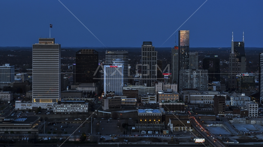 A view of skyscrapers reflecting light in the city skyline at twilight in Downtown Nashville, Tennessee Aerial Stock Photos | DXP002_115_0006