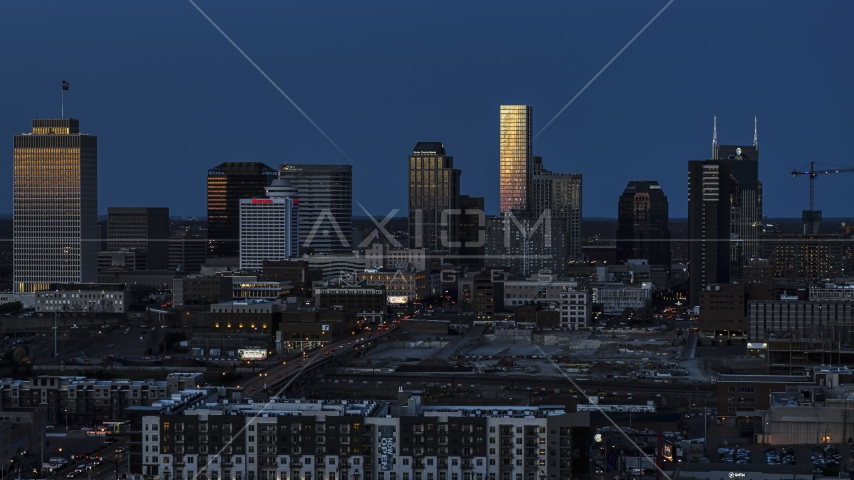 Tall skyscrapers reflecting light in the city skyline at twilight in Downtown Nashville, Tennessee Aerial Stock Photos | DXP002_115_0007