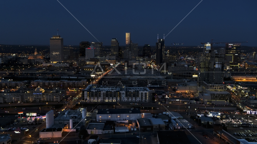 A wide view of the city skyline, high-rise under construction at twilight, Downtown Nashville, Tennessee Aerial Stock Photos | DXP002_115_0010