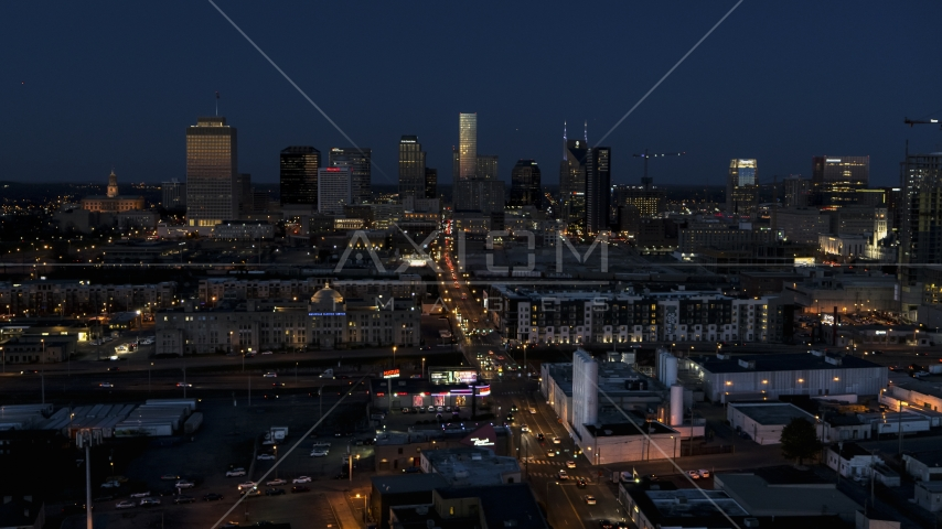 Wide view of traffic on Church Street and city skyline, Downtown Nashville, Tennessee Aerial Stock Photos | DXP002_115_0011