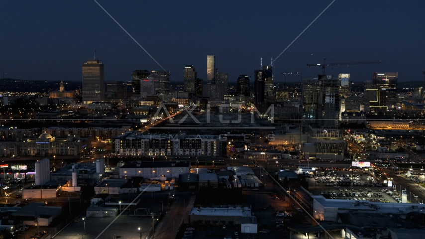 A wide view of city skyline at twilight, near high-rise construction, Downtown Nashville, Tennessee Aerial Stock Photos | DXP002_115_0012