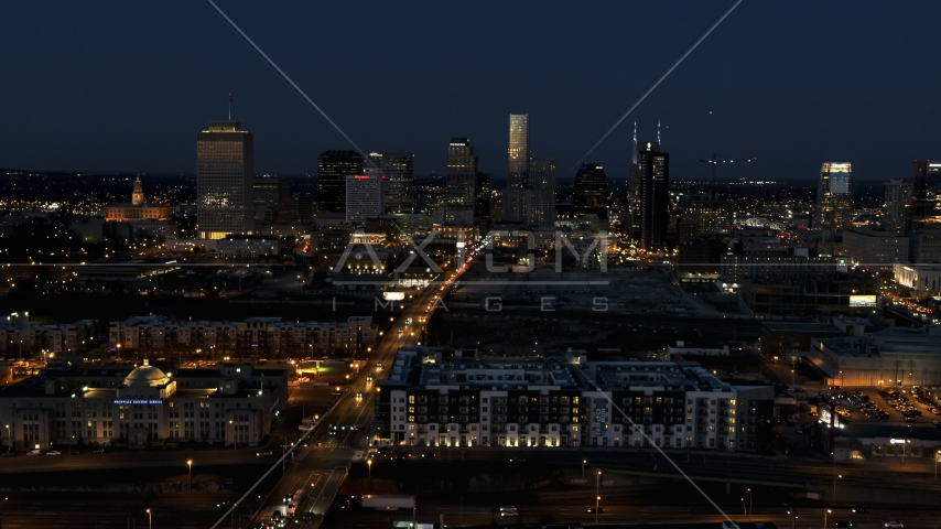 A wide view of the downtown skyline at twilight, Downtown Nashville, Tennessee Aerial Stock Photos | DXP002_115_0014