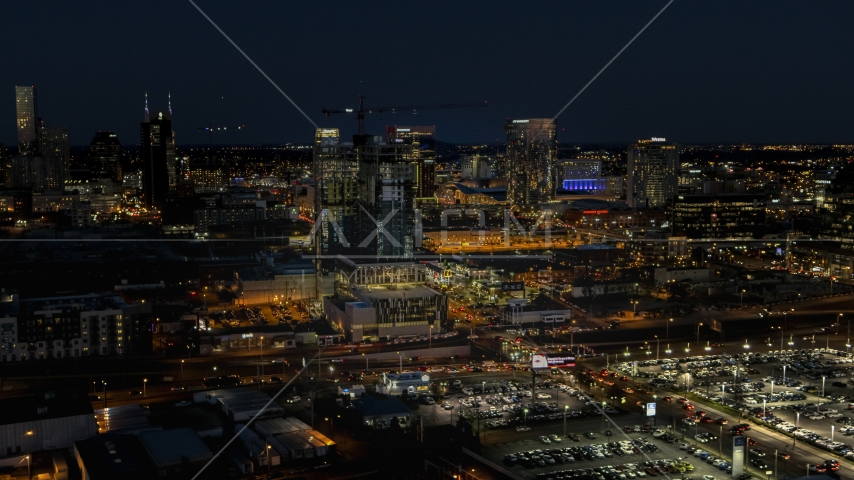 A high-rise building under construction at night, Downtown Nashville, Tennessee Aerial Stock Photos | DXP002_115_0017