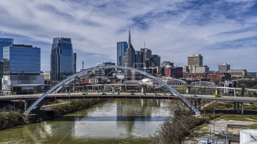 A view of bridge and skyscrapers in Downtown Nashville, Tennessee Aerial Stock Photos | DXP002_116_0003