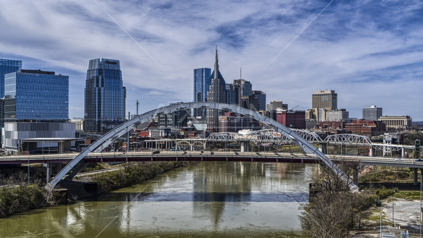 Korean War Veterans Memorial Bridge and skyscrapers in the background in Downtown Nashville, Tennessee Aerial Stock Photos | DXP002_116_0005