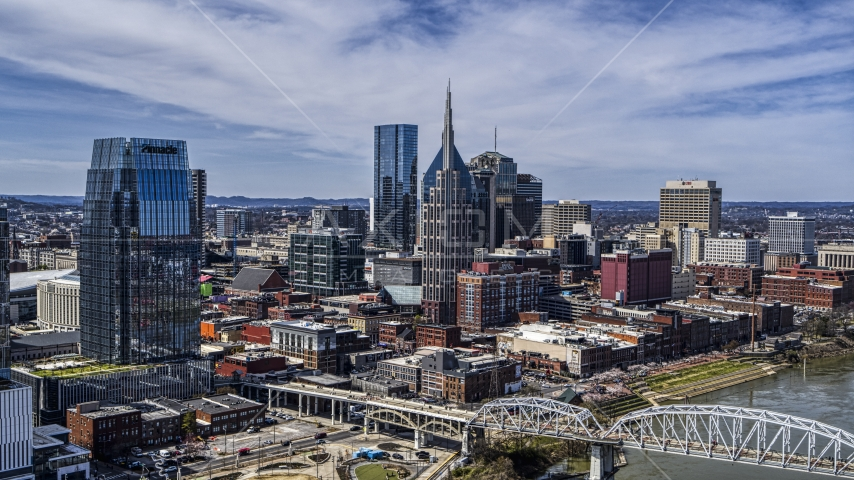 A view of tall city skyscrapers in Downtown Nashville, Tennessee Aerial Stock Photos | DXP002_116_0007