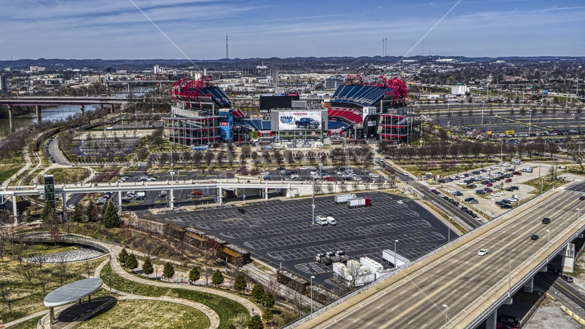 A view of Nissan Stadium seen from a bridge in Nashville, Tennessee Aerial Stock Photos | DXP002_116_0009
